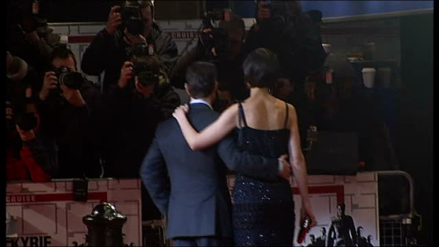 'Valkyrie' / Tom Cruise interview Back view of Cruise and his wife Katie Holmes posing for photocall on red carpet Cruise along on red carpet