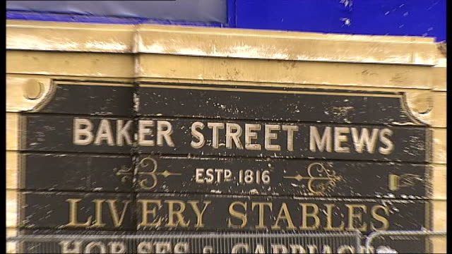 warner bros studios leavesden opens ext 'baker street mews' sign on sherlock holmes film set pull out - sherlock holmes stock videos & royalty-free footage