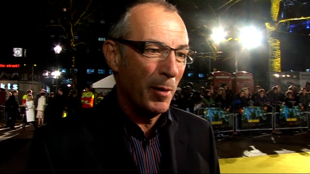 'watchmen' premiere red carpet interviews gibbons being interviewed by itn on sot on seeing his work come to life / was given a badge from the film... - wrap dress stock videos and b-roll footage