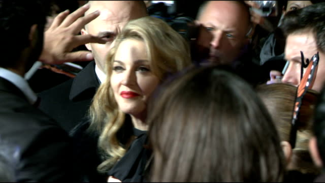 WE London premiere red carpet arrivals Various shots of Madonna talking to press on red carpet/ brief shots of Madonna talking to fans behind barriers
