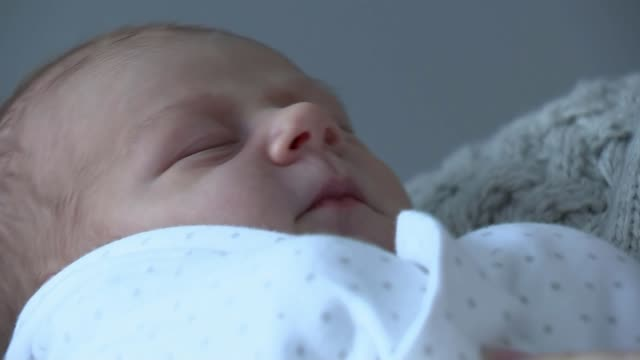 Woman recognises grandfather in restored WWI footage from Peter Jackson war documentary UK Baby sleeping / Jenny Pateman interview Baby being...
