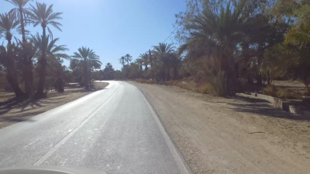 filming from the car like a drone. driving on the road of rural village - pjphoto69 stock videos & royalty-free footage