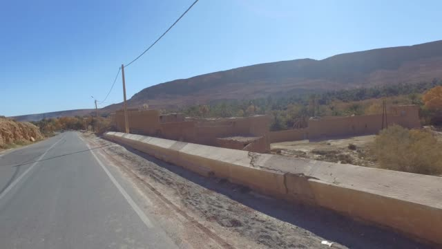 filming from the car like a drone the panoramic view of ziz valley (valee de ziz) - desert oasis - pjphoto69 stock videos & royalty-free footage