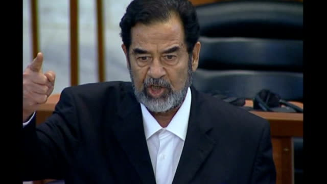 vídeos y material grabado en eventos de stock de baghdad cms saddam hussein speaking in court on first day of his trial on charges including premeditated murder and torture - saddam hussein