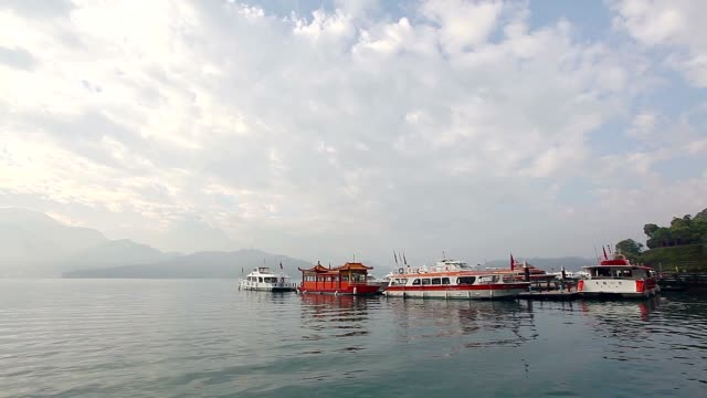 filming of sun moon lake from shueishe pier - wen wu temple stock videos and b-roll footage