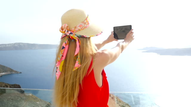 filming/photographing the beauty of santorini - photo shooting stock videos and b-roll footage