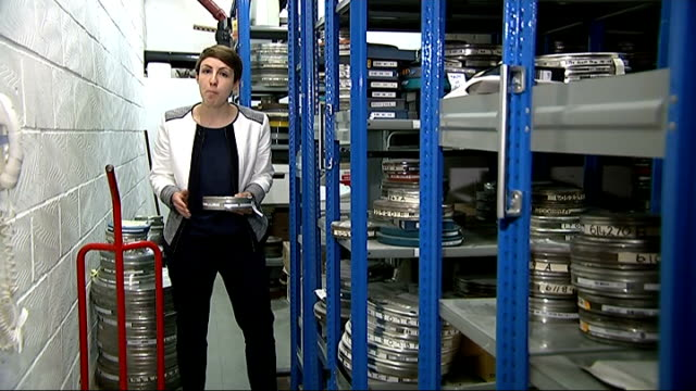 appeal for missing first sherlock holmes film; british film institute : int reporter to camera in film archive cans of film on shelves in archive... - vindsvåning bildbanksvideor och videomaterial från bakom kulisserna