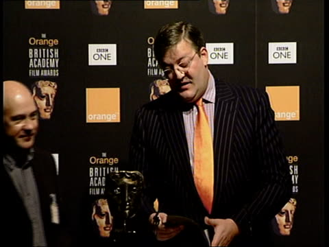 vídeos de stock, filmes e b-roll de bafta nominations announced itn england london leicester square actor and comedian stephen fry announcing nominations for best film sot cold mountain - stephen fry