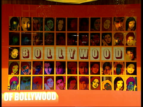 bollywood star in london england london ext bollywood promotion in window of selfridges store people and traffic along past store staging bollywood... - headphones stock videos & royalty-free footage