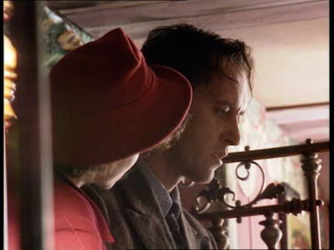 "vídeos de stock e filmes b-roll de british film industry; england: south london: int excerpt filming of ""keep the aspidistra flying"" with helena bonham carter and richard e grant... - richard e. grant"