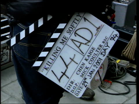 chinese cinema: chen kaige; ext clapperboard for 'killing me softly' film kaige on set - film slate stock videos & royalty-free footage