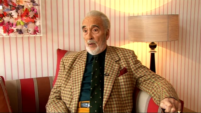 christopher lee interview; christopher lee interview sot - doesn't watch himself on screen unless he has to attend a premiere; explains why he hates... - christopher lee actor stock videos & royalty-free footage