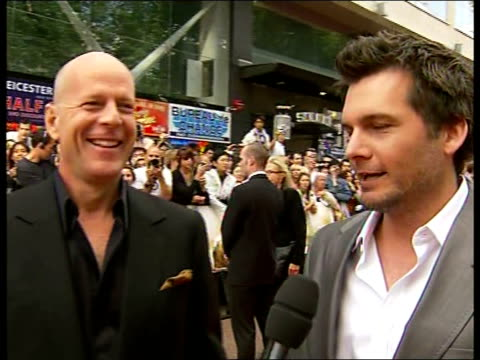 'die hard 4' premiere in london england london leicester square picture *** bruce willis and len wiseman live interviews on red carpet sot on it... - bruce willis stock videos and b-roll footage