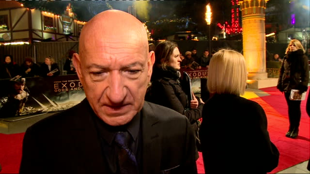 exodus gods and kings red carpet arrivals gvs red carpet / sir ben kingsley interview sot / gvs red carpet / marãa valverde interview sot - ben kingsley stock videos and b-roll footage
