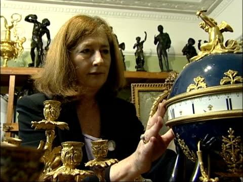 Film prop shop auction CMS Chris Paul looking at artefact Chris Paul as up stairs