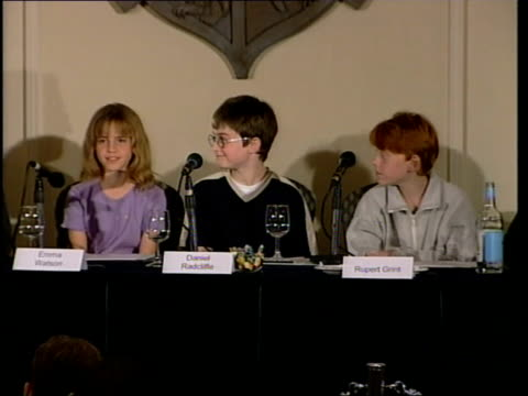 harry potter film: actors press conference; radcliffe, watson and grint sat together as emma watson press conference sot - so far it has turned... - actor stock videos & royalty-free footage