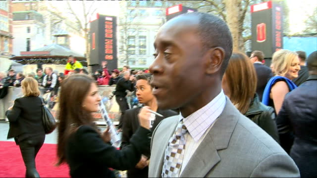 Iron Man 3 premiere Don Cheadle talking to press on red carpet and interview SOT/ Samantha Barks red carpet interview SOT/ Ben Kingsley talking to...