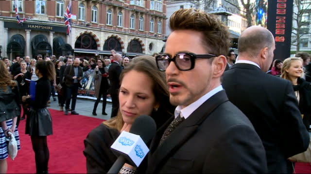 """iron man 3"" premiere; robert downey junior and his wife susan downey talking to press on red carpet/ robert downey junior interview sot/ dermot... - chris eubank sr stock videos & royalty-free footage"