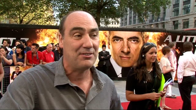 johnny english reborn premiere oliver parker interview sot talks about working with rowan atkinson / don't know what i am working on next / missed... - glee tv show stock videos and b-roll footage