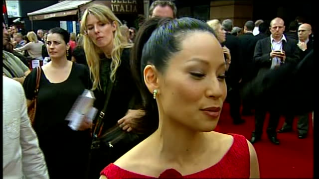 kung fu panda premiere pan to general view of fans cheering sot pan back to lucy liu interview sot saying film is fun and everyone can enjoy it talks... - sedan stock videos & royalty-free footage