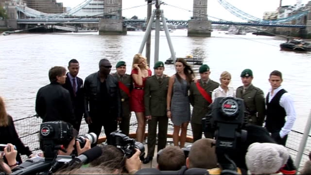 Launch of 'GI Joe Rise Of The Cobra' ENGLAND London EXT Two Royal Marines driving speedboat along River Thames PULL OUT as speedboat passes City Hall...