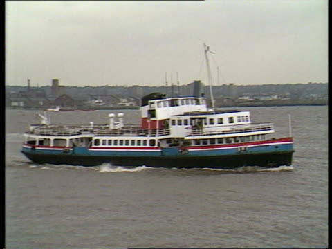 'letter to brezhnev' england liverpool ext mersey ferry along pull out cast and crew members leaning on railings looking out over river - merseyside stock videos and b-roll footage
