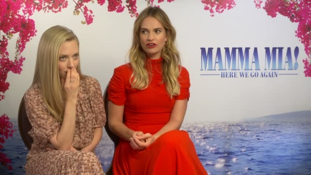 'mamma mia here we go again' junket interviews amanda seyfried lily james christine baranski pierce brosnan england london int amanda seyfried and... - mamma mia stock videos and b-roll footage