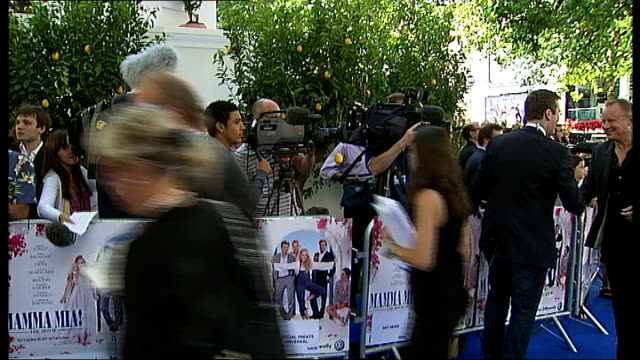 'Mamma Mia' UK premiere in Leicester Square arrivals Stellan Skarsgard speaking to reporters / Benny Andersson being interviewed on red carpet