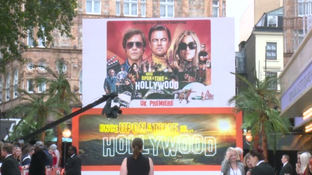 'once upon a time in hollywood' premiere interviews england london leicester square ext poster for the new quentin tarantino film 'once upon a time... - movie poster stock videos & royalty-free footage