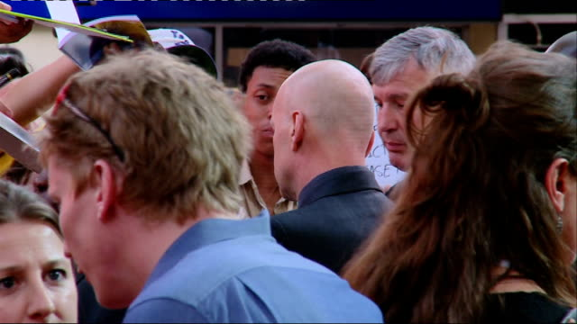 red 2 european premiere bruce willis posing for photocall / willis signing autographs / willis interview with other crew bruce willis interview sot... - bruce willis stock videos and b-roll footage