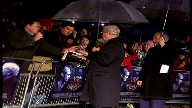 'sleuth' premiere england london leicester square back view actor michael caine signing autographs on arrival at premiere of film 'sleuth' - autogramm stock-videos und b-roll-filmmaterial