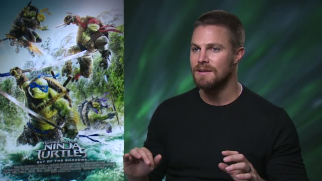 'teenage mutant ninja turtles: out of the shadows': stephen amell interview; england: london: int stephen amell interview sot - ミュータント・タートルズ点の映像素材/bロール