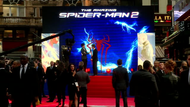 The Amazing Spiderman 2 Premiere Emma Stone on stage / Garfield seen on video screen / red carpet with SpiderMan logo / Stone signing autographs /...
