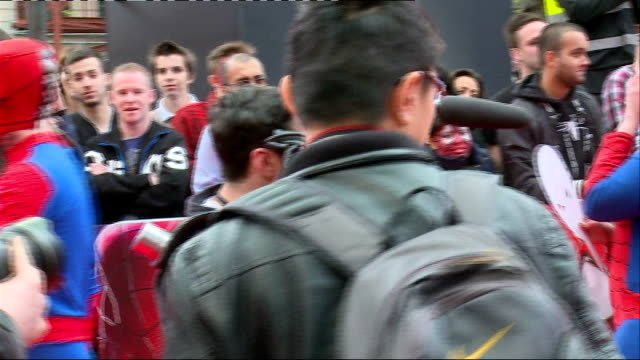 the amazing spider-man 2: premiere; england: london: leicester square: ext various people in spiderman and other costumes arriving for the premiere... - premiere stock videos & royalty-free footage