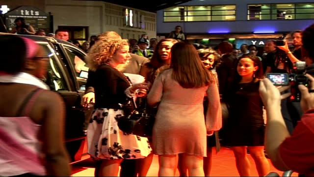 """the devil wears prada"" charity screening: arrivals; car arriving and singer simon webbe out and talking to members of the crowd and signing... - black dress stock videos & royalty-free footage"