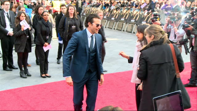 the hangover part iii red carpet england london leicester square the empire ext fans and posters / bradley cooper on red carpet and signing... - the morning after stock videos and b-roll footage