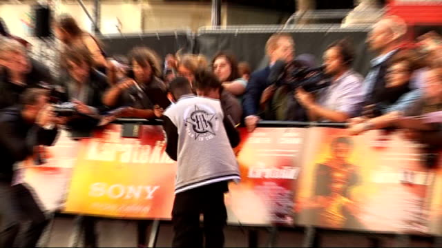 'the karate kid' london premiere tinchy stryder conducting interview bv tinchy stryder signing autographs bv will smith being interviewed and signing... - jaden smith stock videos & royalty-free footage
