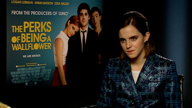 """""""the perks of being a wallflower"""": emma watson interview; england: london: int emma watson interview sot - on the film's range, parents going with... - bucket list stock videos & royalty-free footage"""