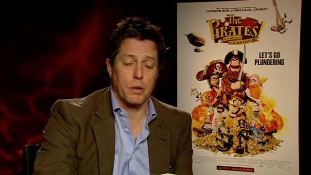 'the pirates in an adventure with scientists' interview hugh grant david tennant london int hugh grant interview sot writing and directing a film... - anweisungen geben stock-videos und b-roll-filmmaterial