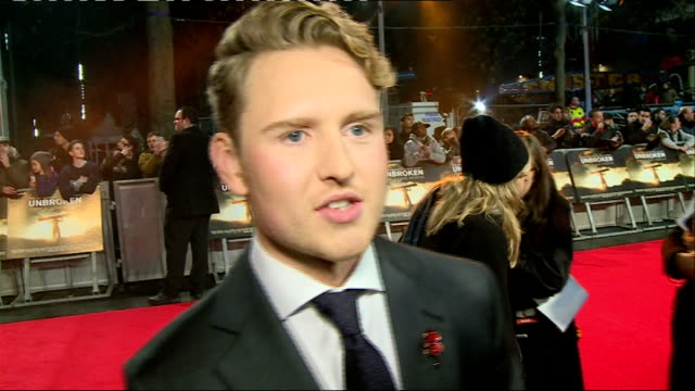 'Unbroken' premiere Red carpet arrivals and interviews Actor Ross Anderson talking to press on red carpet / Jolie with Chelsea Pensioners / Ross...