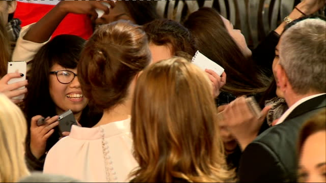 'Unbroken' premiere Red carpet arrivals and interviews Angelina Jolie taking selfie photograph with fans / More Jolie meeting fans on red carpet /...