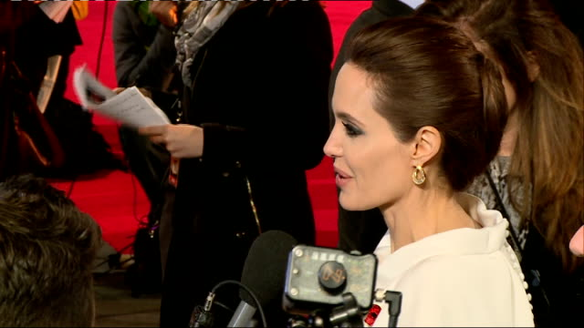 'Unbroken' premiere Red carpet arrivals and interviews Various Jack O'Connell and Angelina Jolie as chat to press on red carpet / Jolie along to sign...