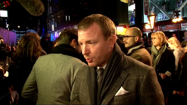 'sherlock holmes: a game of shadows': red carpet interviews; stephen fry speaking to reporter sot guy ritchie interview sot - on making the second... - スティーブン フライ点の映像素材/bロール