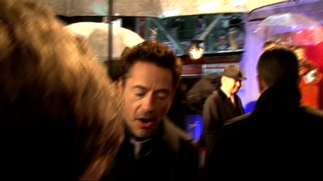 'Sherlock Holmes A Game Of Shadows' red carpet interviews Robert Downey Jr interview SOT On not caring about awards / On the story of Sherlock Holmes...