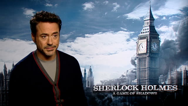 'sherlock holmes: a game of shadows': robert downey jr interview; england: london: int robert downey jr interview sot - [on iron man and sherlock as... - sherlock holmes stock videos & royalty-free footage