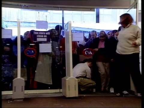 Final CA shop closes in Britain ITN Bradford GVs Customer queuing outside CA store INT BV Security guard unlocking door PULL OUT as customers towards...