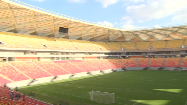 final construction work on vivaldão football stadium in manaus in the lead up to the 2014 world cup in brazil - 2014 stock videos & royalty-free footage
