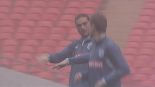 final day of transfer window wembley andy carroll training - transfer stock videos and b-roll footage