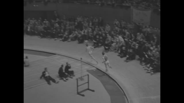 ms final lap of baxter mile race as two men race around madison square garden's indoor track at the new york athletic club's track meet audience... - men's track stock videos and b-roll footage