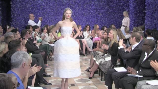 Final round and Designer salute at the end of Dior Haute Couture Fashion Show in Paris Final round and Raf Simons Salute at Dior HC FW on July 02...